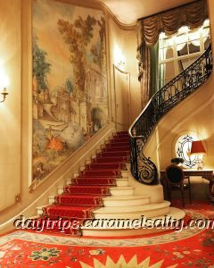 A Grand Staircase at the Ritz Hotel on Piccaddiily