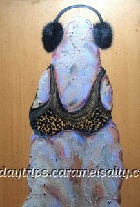 A Painting Of A Dressed Up Termite Mound