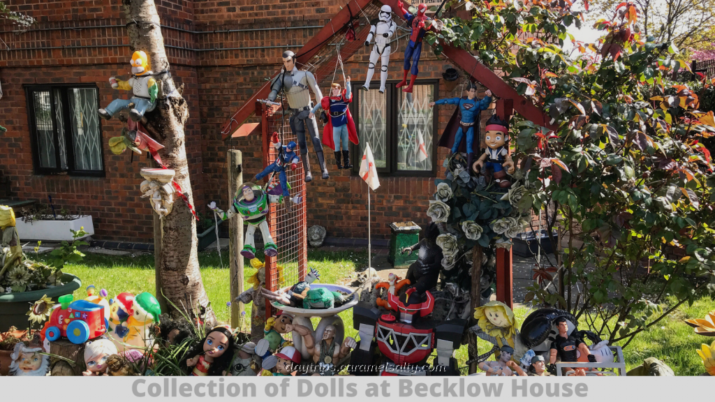 Collection of Dolls in the Gardens of Becklow House along Uxbridge Road